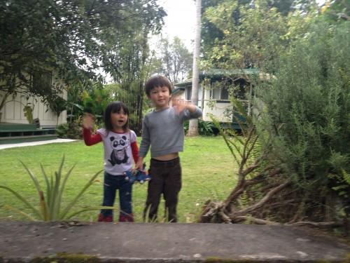 2 of Derek and Heeran's beautiful kids waving good-bye.