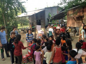 YWAM team giving out gift boxes in a village